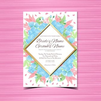 Blauwe bloemenhuwelijksuitnodiging met schitterende bloemen