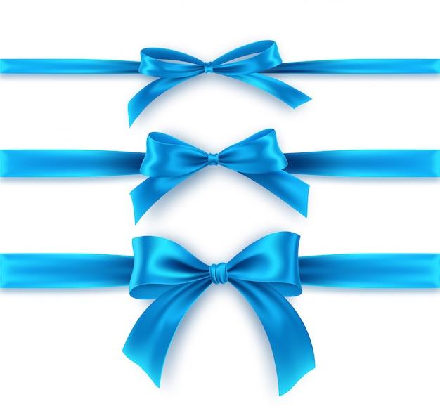 Blauwe boog en lint op witte achtergrond instellen. realistische blauwe strik.