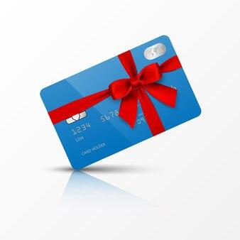 Blauwe creditcard met rode strik en lint