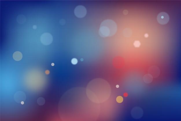 Blauwe en rode achtergrond met kleurovergang met bokeh-effect