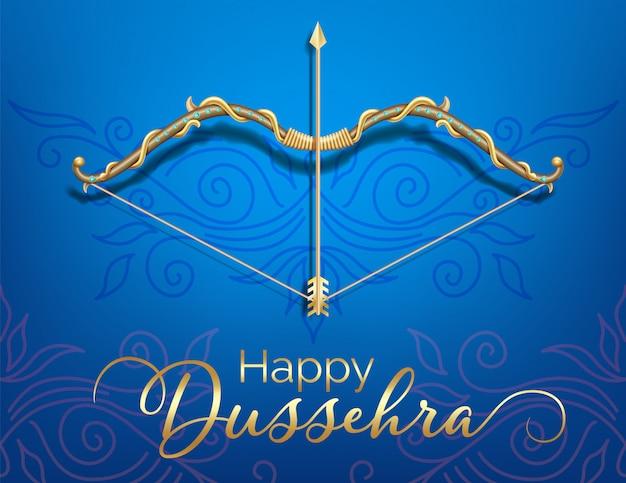 Blauwe gelukkige dussehra-festivalkaart met gouden gevormde pijl en boog en kristallen op document kleurenachtergrond.