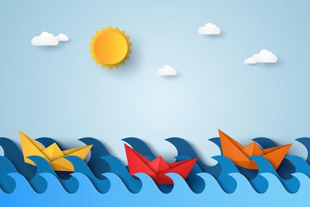 Blauwe golven in de oceaan met bootzeilen, papierkunststijl