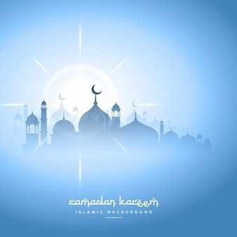 Blauwe hemel ramadan kareem achtergrond met moskee silhouet