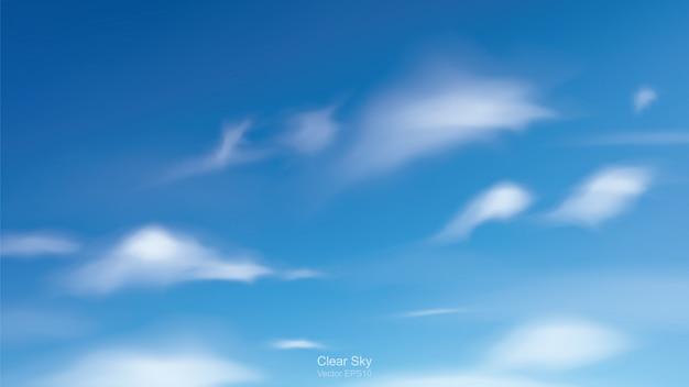 Blauwe hemelachtergrond met witte wolken.