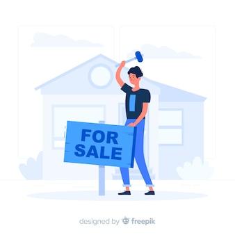 Blauwe jongen die een huis vlakke stijl verkoopt