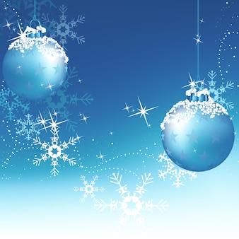 Blauwe kerstachtergrond met hangende kerstballen en sneeuwvlokken
