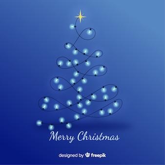 Blauwe kerstmisachtergrond met gloeilampenboom