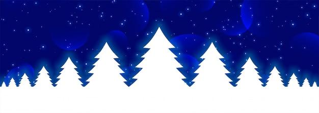 Blauwe kerstmisbanner met witte gloeiende kerstmisbomen