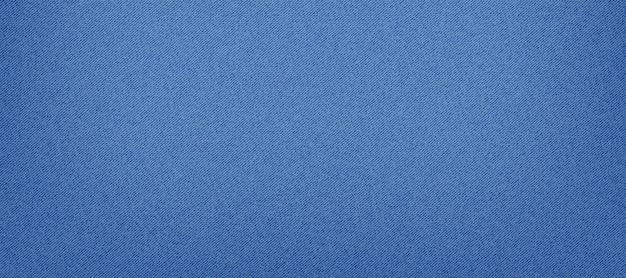 Blauwe klassieke jeans denim textuur. lichte jeanstextuur.