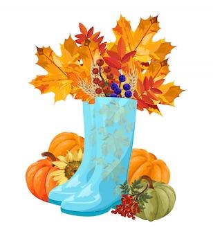 Blauwe laarzen vol met herfstbladeren