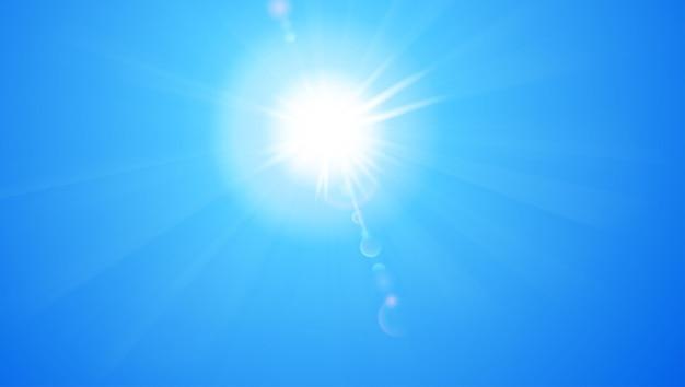 Blauwe lucht met zon en lens flare-achtergrond