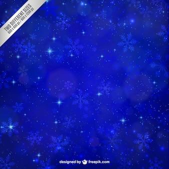 Blauwe sneeuwvlokken achtergrond met sterren