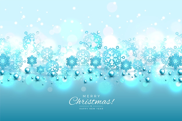 Blauwe sneeuwvlokkenachtergrond met glittereffect
