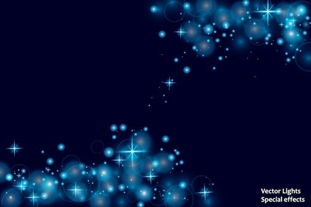Blauwe vonken en sterren schitteren speciaal lichteffect. sprankelende magische stofdeeltjes