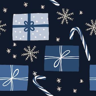 Blauwe winter nieuwjaar kerstmis achtergrond met geschenkdoos en vallende sneeuw naadloze patroon