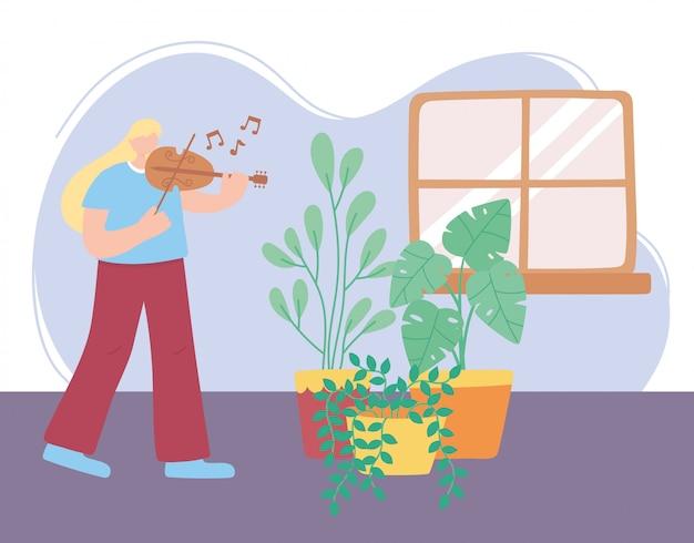 Blijf thuis, meisje speelt viool in kamer met planten, zelfisolatie, activiteiten in quarantaine voor coronavirus
