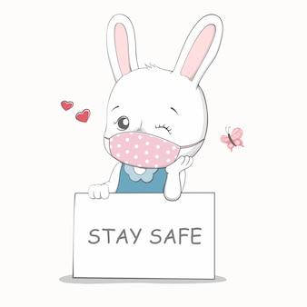 Blijf veilig bericht met schattig konijn met gezichtsmasker cartoon hand getrokken
