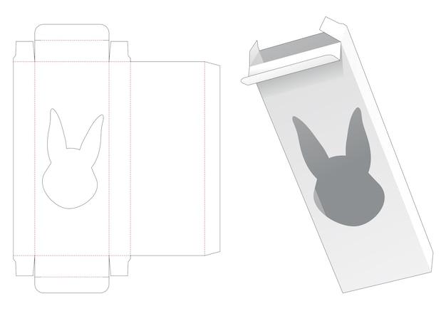 Blikken en hoge doos met gestanst sjabloon in de vorm van een konijn in de vorm van een raam