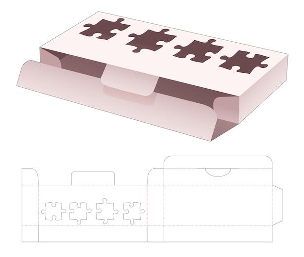Blikken en korte doos met gestanst sjabloon in de vorm van een venster in de vorm van een puzzel
