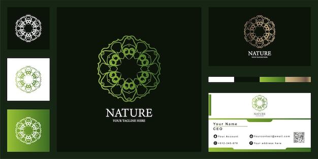 Bloem mandala of sieraad luxe logo sjabloonontwerp met visitekaartje