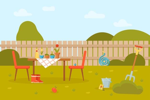 Bloemen in potten op tafel en stoelen in de tuin met hek.