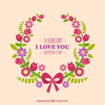 Bloemen kroon met boog en de boodschap van de liefde