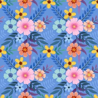 Bloemen naadloos patroon op blauw