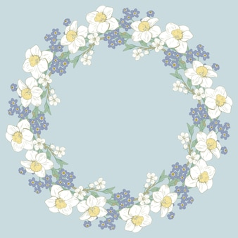 Bloemen rond frame op blauwe achtergrond.