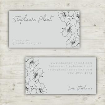 Bloemen visitekaartjesjabloon met handgetekende elementen