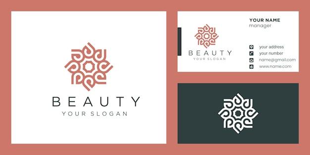 Bloemlogo-ontwerp met lijnstijl en visitekaartje