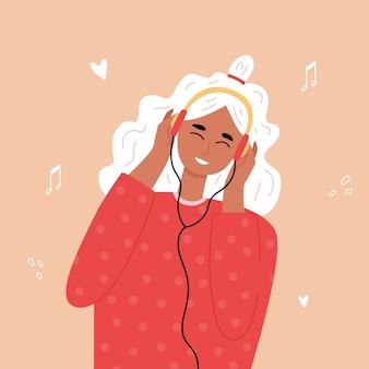 Blonde hipster tienermeisje luisteren naar muziek met een koptelefoon