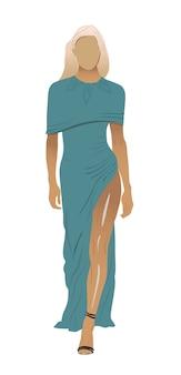 Blonde vrouw zonder gezicht in lange blauwgroen jurk en zwarte lage schoenen