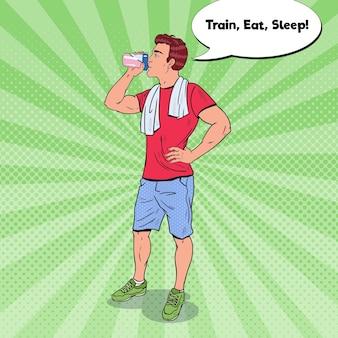Bodybuilder die eiwitshake drinkt