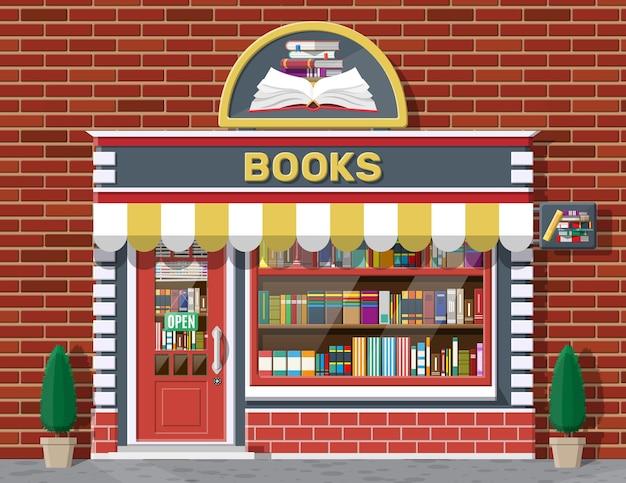 Boekwinkel winkel buitenkant. boeken winkel bakstenen gebouw. onderwijs- of bibliotheekmarkt. boeken in etalage op planken. straatwinkel, winkelcentrum, markt, boetiekgevel. vector vlakke stijl illustratie.