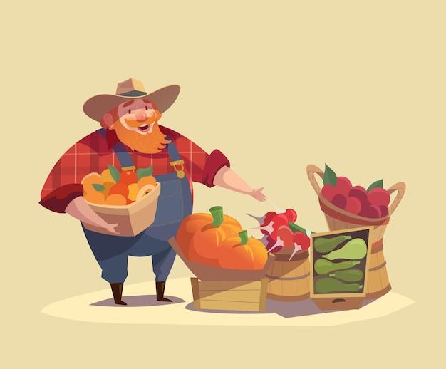 Boer draagt een hoed met een emmer vol groenten en fruit. plantaardige kraam buitenshuis achtergrond. plantaardige beurs. voedselmarkt.
