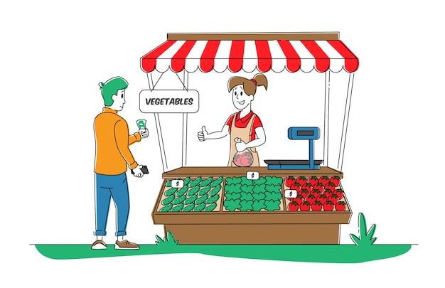Boer verkoopt verse groenteproducten aan mannelijke klant