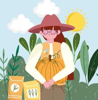 Boerenmeisje houdt pompoen vast