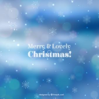Bokeh blauwe kerst achtergrond van sneeuwvlokken
