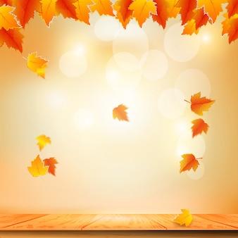 Bokeh lichten en herfstbladeren vallen op de tafel.