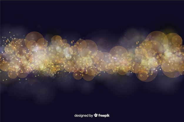 Bokehachtergrond met gouden deeltjes