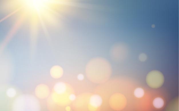 Bokehbellen en zon flitsen over blauwe achtergrond