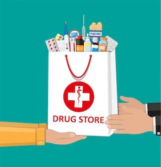Boodschappentas met medische pillen en flessen