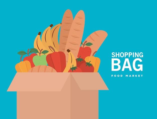 Boodschappentas voedselmarkt en doos vol met marktproducten