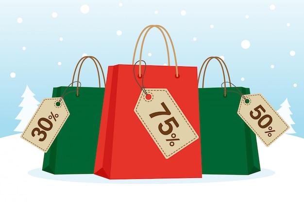 Boodschappentassen met tag of label voor kerst in de sneeuw