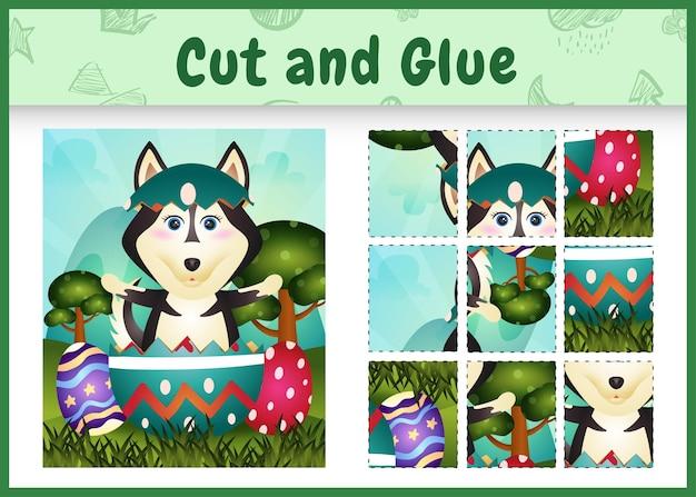 Bordspel voor kinderen geknipt en gelijmd als thema pasen met een schattige husky hond in het ei