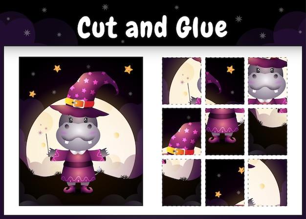Bordspel voor kinderen knippen en lijmen met een schattig nijlpaard met halloween-kostuum