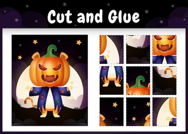 Bordspel voor kinderen knippen en lijmen met een schattige tijger met halloween-kostuum
