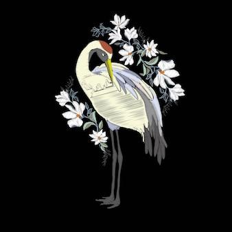 Borduurwerk met kraanvogel. mode decoratie.