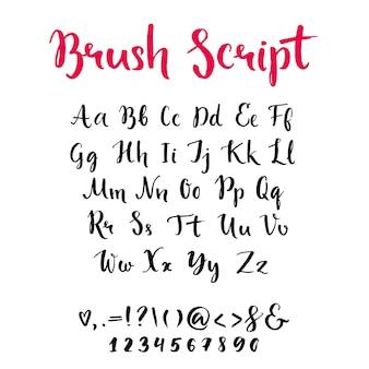 Borstelscript met kleine letters en hoofdletters toetsaanslagen en cijfers volledig alfabet met de hand geschreven