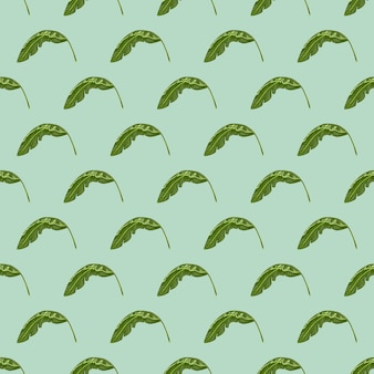Bos naadloos patroon met groene kleine bananenbladeren afdrukken. pastelblauwe achtergrond. abstracte stijl.